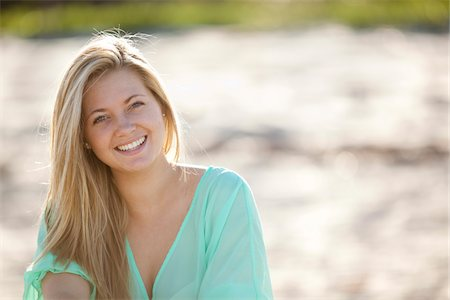 Close-up Portrait of Young Woman on Beach, Looking at Camera and Smiling, Palm Beach Gardens, Palm Beach County, Florida, USA Stock Photo - Premium Royalty-Free, Code: 600-06701908