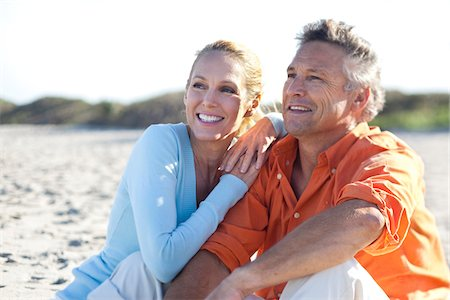 Mature Couple Sitting on Beach, Jupiter, Palm Beach County, Florida, USA Stock Photo - Premium Royalty-Free, Code: 600-06701930
