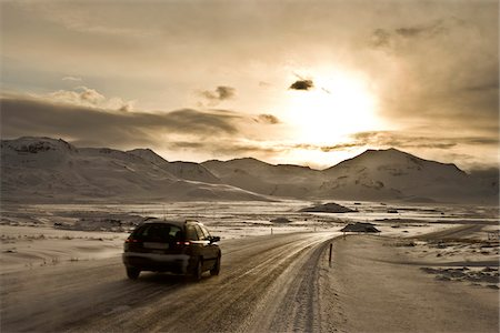 roads and sun - Car driving on snowy road in Iceland Stock Photo - Premium Royalty-Free, Code: 600-06702152