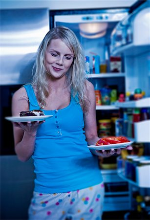 fridge - Young Woman Deciding between Cake or Veggies by Open Refrigerator Stock Photo - Premium Royalty-Free, Code: 600-06714005