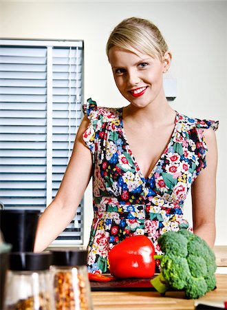 Young Woman in Kitchen with Vegetables Stock Photo - Premium Royalty-Free, Code: 600-06714002