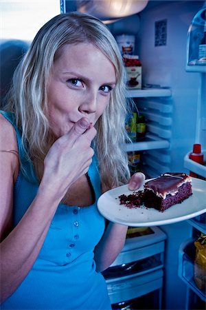 fridge - Young Woman Eating Cake by Open Refrigerator Stock Photo - Premium Royalty-Free, Code: 600-06714003