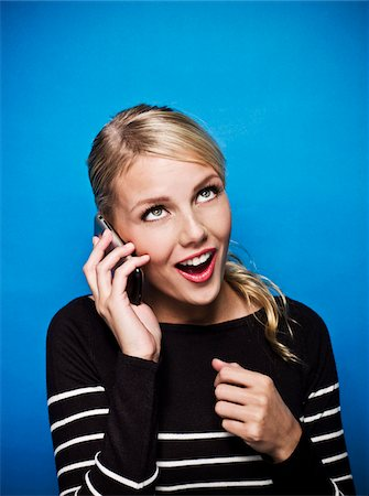 Young Woman receiving Good New over the Phone, Studio Shot Stock Photo - Premium Royalty-Free, Code: 600-06714020