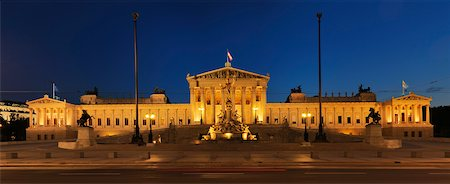 Austrian Parliament and Pallas Athene statue in Vienna illuminated at dusk. Vienna, Austria. Stock Photo - Premium Royalty-Free, Code: 600-06714189