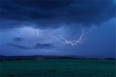 Lightning in Sky over Field. Bavaria, Germany. Stock Photo - Premium Royalty-Free, Code: 600-06732568