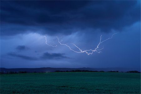 Lightning in Sky over Field. Bavaria, Germany. Stock Photo - Premium Royalty-Free, Code: 600-06732568