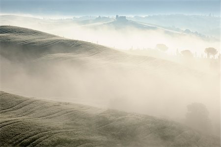 Typical Tuscany landscape in morning with fog near San Quirico d'Orcia. Val d'Orcia, Orcia Valley, Siena district, Tuscany, Toscana, Italy. Stock Photo - Premium Royalty-Free, Code: 600-06732591