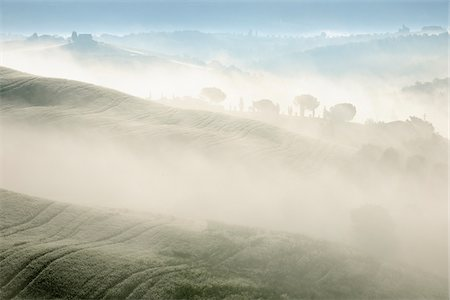 fog (weather) - Typical Tuscany landscape in morning with fog near San Quirico d'Orcia. Val d'Orcia, Orcia Valley, Siena district, Tuscany, Toscana, Italy. Stock Photo - Premium Royalty-Free, Code: 600-06732592