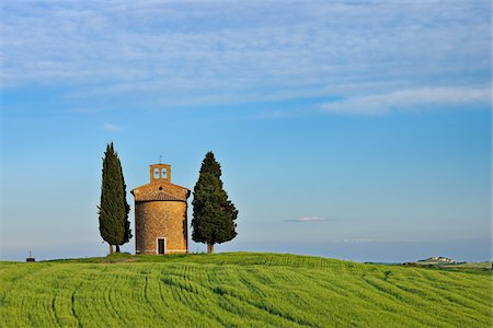 Chapel of Vitaleta with Cypress Trees in green field, Val d´Orcia, Siena Province, Tuscany, Italy. Stock Photo - Premium Royalty-Free, Code: 600-06732620