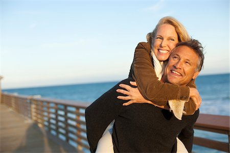 Mature Couple having Fun Walking along Pier, Jupiter, Palm Beach County, Florida, USA Stock Photo - Premium Royalty-Free, Code: 600-06732647