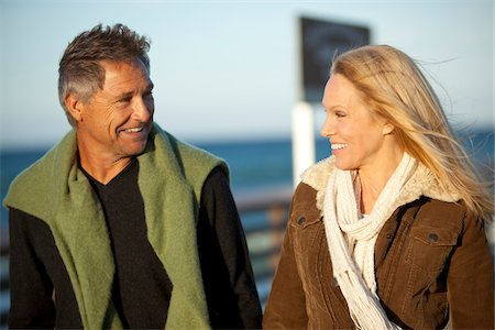 Mature Couple Walking along Pier, Jupiter, Palm Beach County, Florida, USA Stock Photo - Premium Royalty-Free, Code: 600-06732643