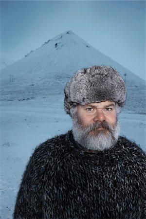 fur - Man with gray beard wearing gray fur hat outdoors at winter in Iceland. Stock Photo - Premium Royalty-Free, Code: 600-06732715