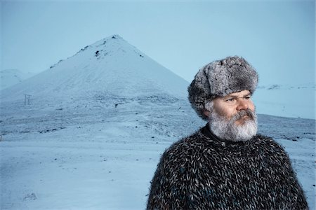 fur - Man with gray beard wearing gray fur hat outdoors at winter in Iceland. Stock Photo - Premium Royalty-Free, Code: 600-06732716