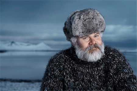 fur - Man with gray beard wearing gray fur hat outdoors at winter in Iceland. Stock Photo - Premium Royalty-Free, Code: 600-06732710
