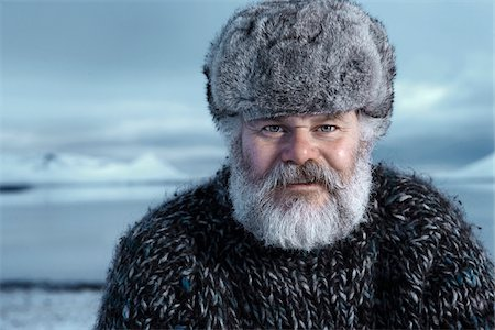 fur - Man with gray beard wearing gray fur hat outdoors at winter in Iceland. Stock Photo - Premium Royalty-Free, Code: 600-06732711