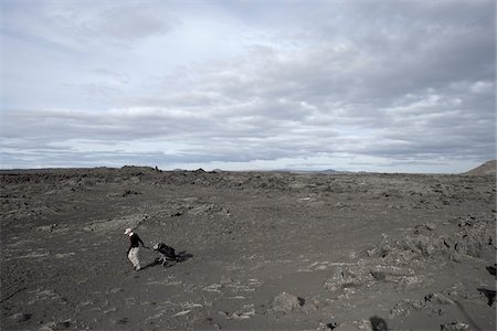 rugged landscape - Man Playing Golf in Lava Field, Reykjanes, Iceland Stock Photo - Premium Royalty-Free, Code: 600-06758272