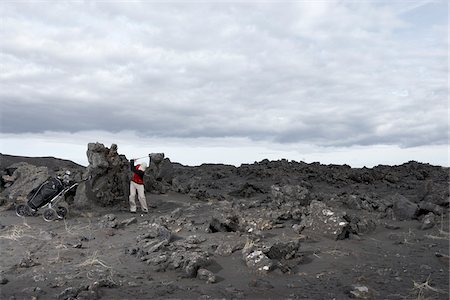 rugged landscape - Man Playing Golf in Lava Field, Reykjanes, Iceland Stock Photo - Premium Royalty-Free, Code: 600-06758290