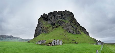 Old Run Down Farm by Rock Outcrop, South Iceland, Iceland Stock Photo - Premium Royalty-Free, Code: 600-06752061