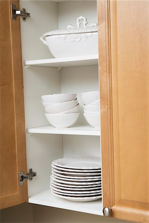 Stacked Dishes in Kitchen Cupboard Stock Photo - Premium Royalty-Free, Code: 600-06752176