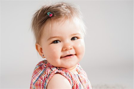 Head and Shoulders Portrait of Baby Girl, Studio Shot Stock Photo - Premium Royalty-Free, Code: 600-06752375