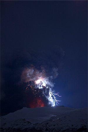 Eyjafjallajokull Volcano at Night, Lightning and Lava inside Ash Cloud, Iceland Stock Photo - Premium Royalty-Free, Code: 600-06752424