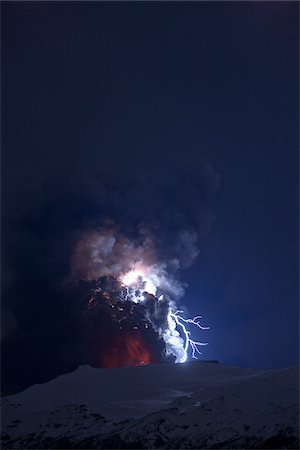 Eyjafjallajokull Volcano at Night, Lightning and Lava inside Ash Cloud, Iceland Stock Photo - Premium Royalty-Free, Code: 600-06752424