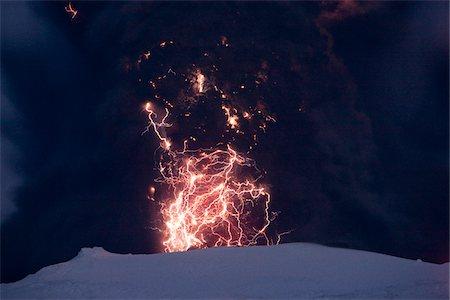Eyjafjallajokull Volcano at Night, Lightning and Lava inside Ash Cloud, Iceland Stock Photo - Premium Royalty-Free, Code: 600-06752423