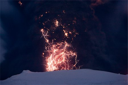 Eyjafjallajokull Volcano at Night, Lightning and Lava inside Ash Cloud, Iceland Stock Photo - Premium Royalty-Free, Code: 600-06752423