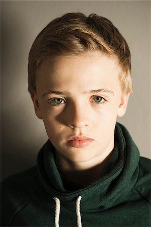 Head and Shoulders Portrait of Boy, Studio Shot Stock Photo - Premium Royalty-Free, Code: 600-06752468