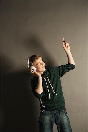 Boy Listening to Music with Headphones, Studio Shot Stock Photo - Premium Royalty-Free, Code: 600-06752478
