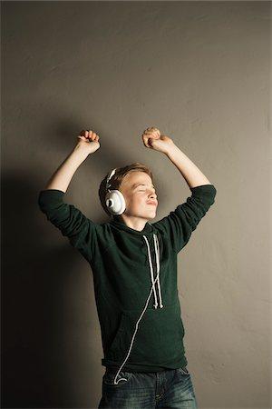 preteen dancing - Boy Listening to Music with Headphones, Studio Shot Stock Photo - Premium Royalty-Free, Code: 600-06752479