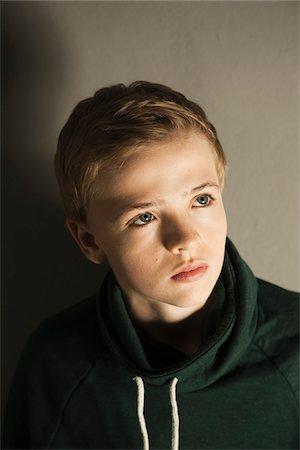 Head and Shoulders Portrait of Boy, Studio Shot Stock Photo - Premium Royalty-Free, Code: 600-06752470