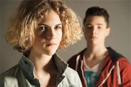 Close-up of Teenage Girl and Boy, Studio Shot Stock Photo - Premium Royalty-Free, Code: 600-06752491