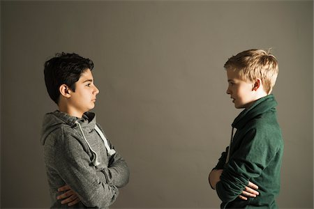 Teenage Boys with Arms Crossed looking at Each Other, Studio Shot Stock Photo - Premium Royalty-Free, Code: 600-06752505