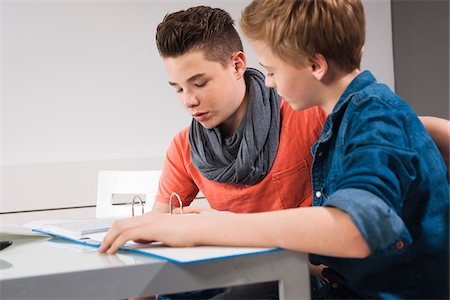 Teenage Boys Studying Together, Studio Shot Stock Photo - Premium Royalty-Free, Code: 600-06752518