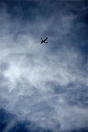 Silhouette of Airplane Flying in Sky Stock Photo - Premium Royalty-Free, Code: 600-06752546