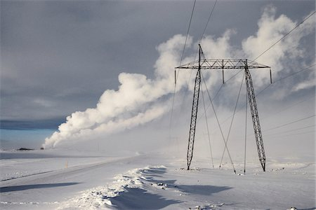 Power Lines in Winter Landscape with Steam from nearby Geothermal Power Plant in Background, Hellisheidi, Iceland Stock Photo - Premium Royalty-Free, Code: 600-06752554
