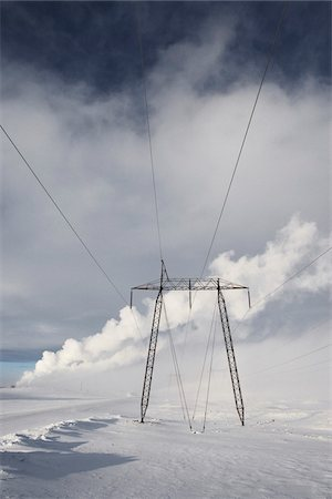 Power Lines in Winter Landscape with Steam from nearby Geothermal Power Plant in Background, Hellisheidi, Iceland Stock Photo - Premium Royalty-Free, Code: 600-06752555