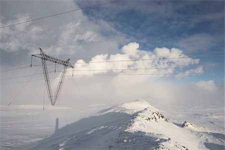 Power Lines in Winter Landscape with Steam from nearby Geothermal Power Plant in Background, Hellisheidi, Iceland Stock Photo - Premium Royalty-Free, Code: 600-06752556