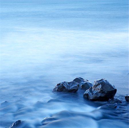 Long Exposure of River Flowing by Rocks, Olafsvik, Snaefellsnes Peninsula, Iceland Stock Photo - Premium Royalty-Free, Code: 600-06752550