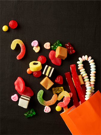 Assorted Candy Spilling out of Bag Stock Photo - Premium Royalty-Free, Code: 600-06773327