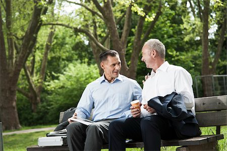 people sitting on bench - Businessmen Talking on Park Bench, Mannheim, Baden-Wurttemberg, Germany Stock Photo - Premium Royalty-Free, Code: 600-06773350