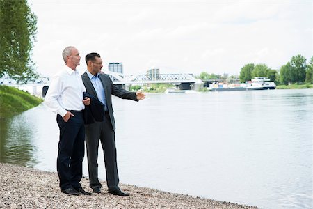 Businessmen Standing by River, Mannheim, Baden-Wurttemberg, Germany Stock Photo - Premium Royalty-Free, Code: 600-06773353