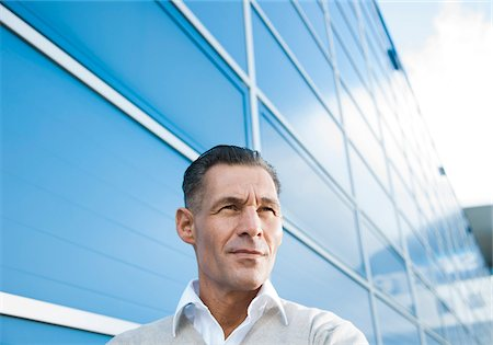 portrait looking away - Portrait of Businessman Outdoors, Mannheim, Baden-Wurttemberg, Germany Stock Photo - Premium Royalty-Free, Code: 600-06773364