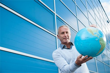 Businessman Holding Globe Outdoors, Mannheim, Baden-Wurttemberg, Germany Stock Photo - Premium Royalty-Free, Code: 600-06773367
