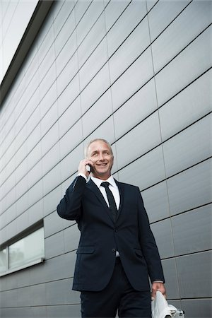 Businessman using Cell Phone Outdoors, Mannheim, Baden-Wurttemberg, Germany Stock Photo - Premium Royalty-Free, Code: 600-06773372