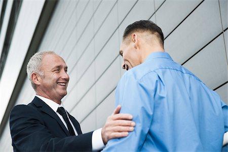 Businessmen Talking Outdoors, Mannheim, Baden-Wurttemberg, Germany Stock Photo - Premium Royalty-Free, Code: 600-06773373