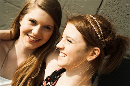 Close-up portrait of young women outdoors Stock Photo - Premium Royalty-Free, Code: 600-06786785