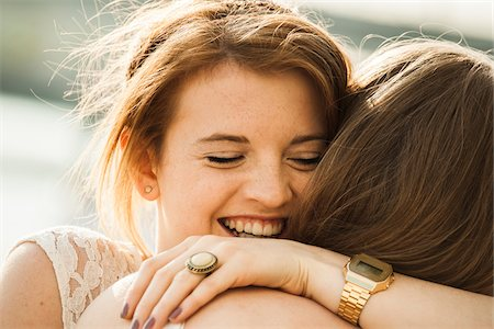 friend (female) - Close-up of young women embracing outdoors Stock Photo - Premium Royalty-Free, Code: 600-06786806