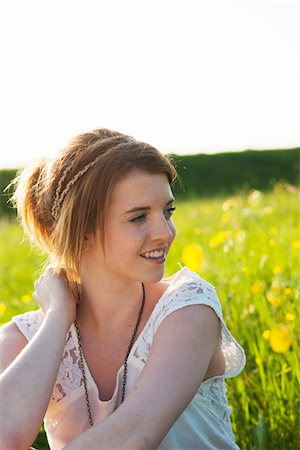 Portrait of teenage girl sitting in field, Germany Stock Photo - Premium Royalty-Free, Code: 600-06786809